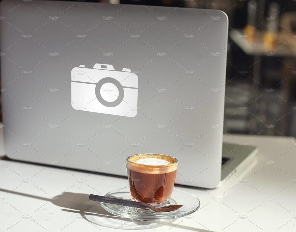 Complete Front View Modern laptop and coffee Cup Mockup 1