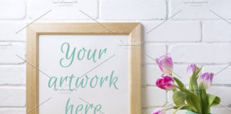 Wooden square frame mockup with flower