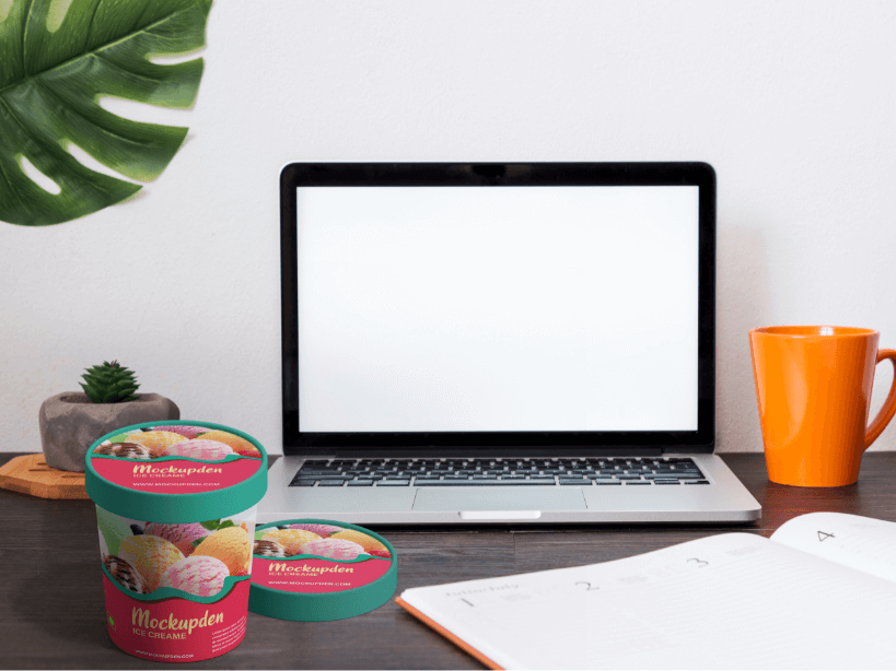 Free Ice Cream Cup On Work Table Mockup | PSD Template 1