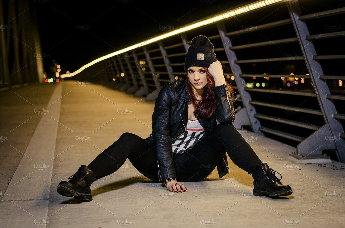 A Beautiful Women Sitting On The Bridge Wearing Black Outfit WithBeanie PSD Template