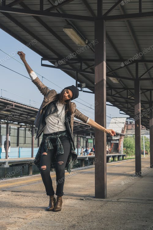 A Dancing Girl Standing In The Metro Station PSD Template