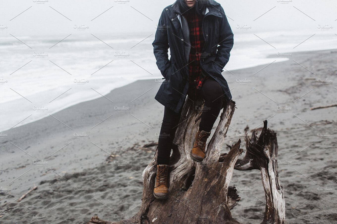 A Man Sitting On A Destroyed Tree Wearing HisBeanie Design template