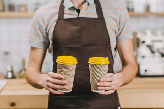 A Man Wearing Apron Has Two Drinks In His Hand Mockup