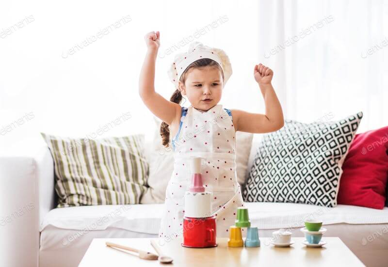 A Small Girl At Home Playing In Apron Mockup