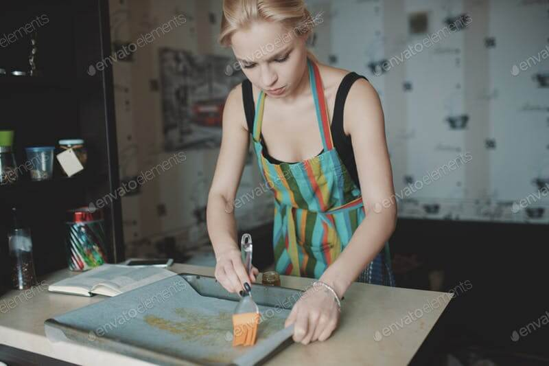 A Women Preparing Food In A Colorful Apron Template