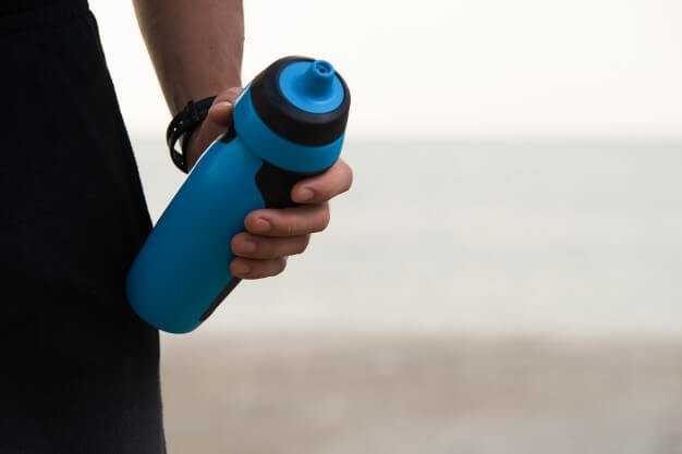 Male Holding Sipper Bottle Mockup
