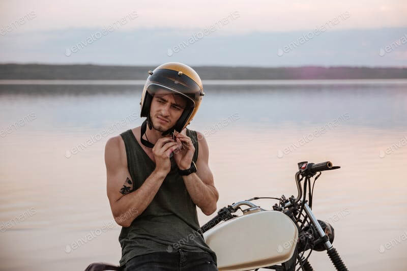 Man Trying To pull Out His Motorcycle Helmet Mockup