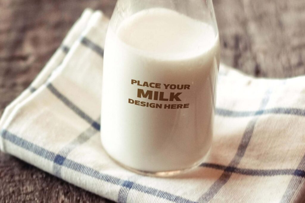 Milk Bottle Placed On A Hand Towel PSD File