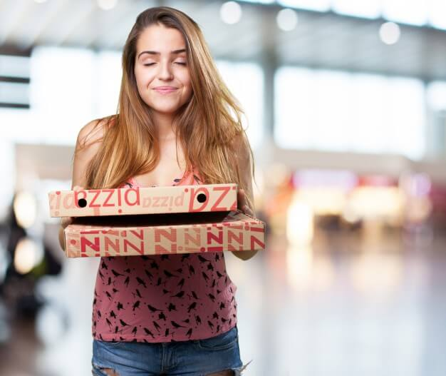 Teen holding two pizza boxes Picture Mockup