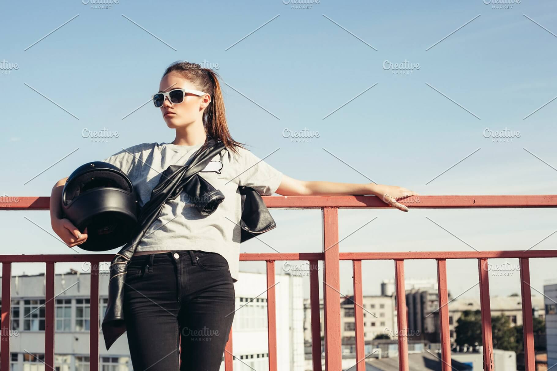 Young Female Holding Her Motorcycle Helmet In Her Arm Mockup