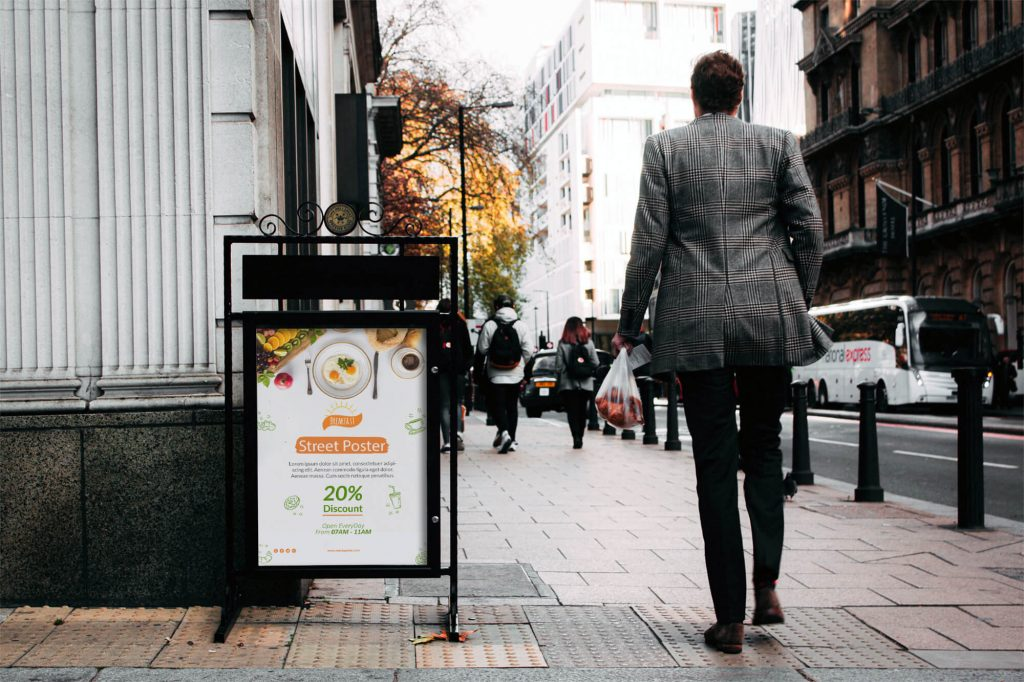Free Street Poster On Stand Mockup