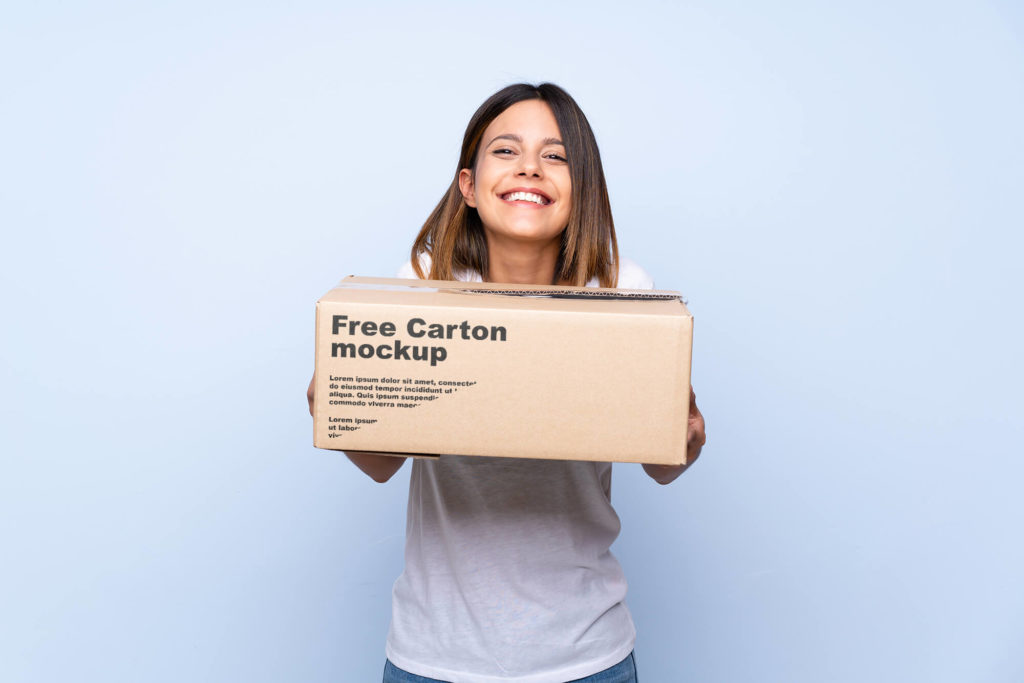 Free Woman Holding Carton Mockup PSD Template