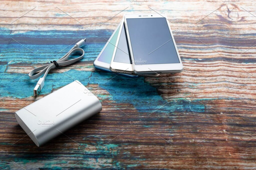 Charger and several smartphones.