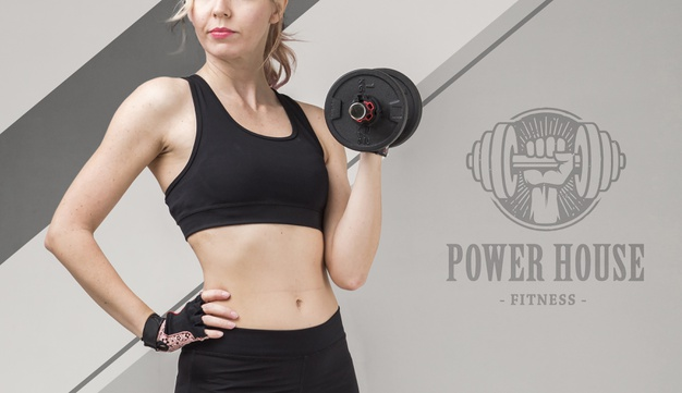 Front view of athletic woman holding weights Free Psd