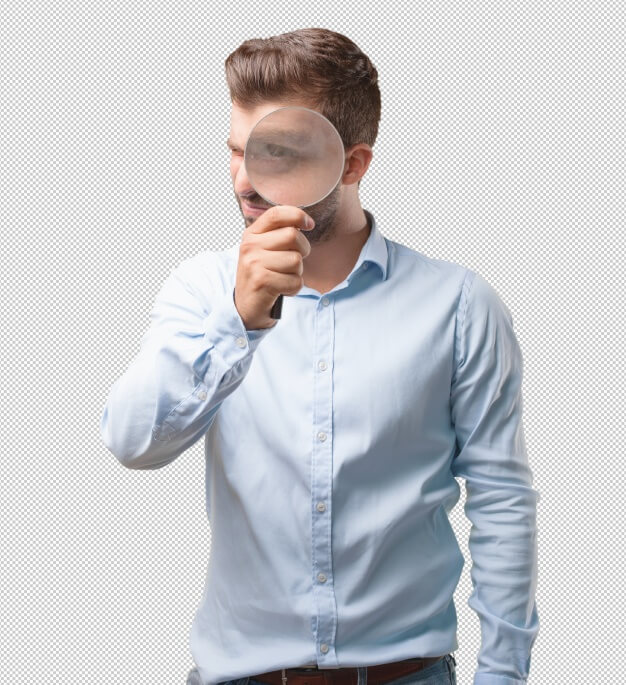 Handsome young man with magnifying glass Premium Psd