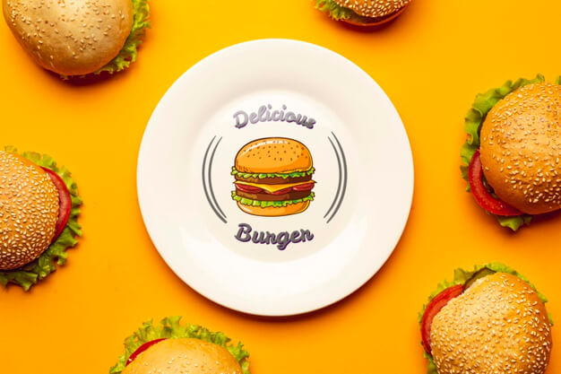 Mock-up plate surrounded by delicious burgers Free Psd