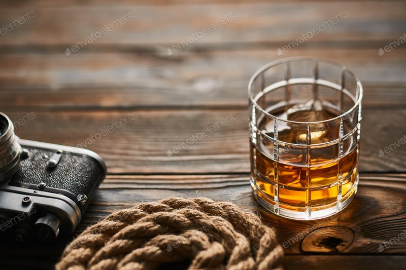 A Camera And A Glass Of Whiskey On The Wooden Table Mockup.