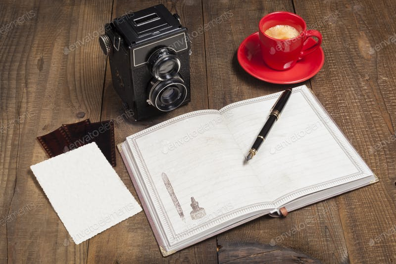 A Camera Placed With A Blank Copy And Pen Mockup.
