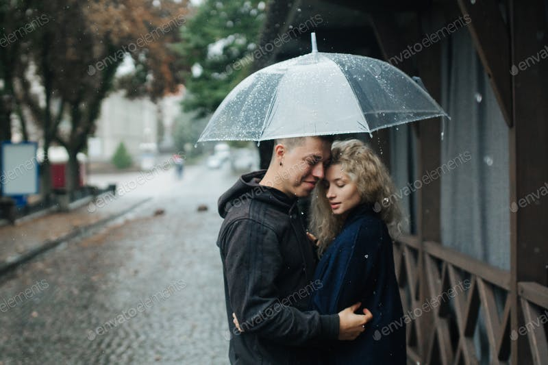 A Couple Holding A Transparent Umbrella PSD Template.