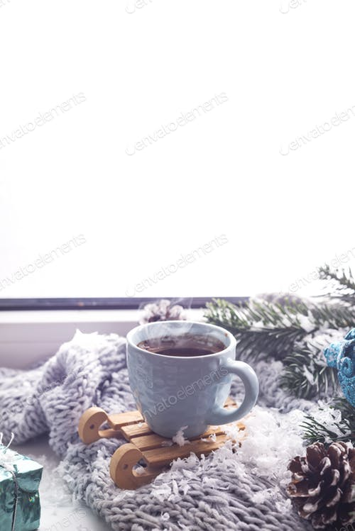 A Cup Of Coffee Is Placed On The Woolen Blanket Mockup.