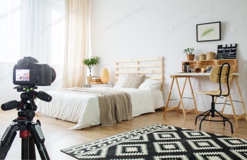 A Digital Camera Placed In The Bedroom PSD Mockup.