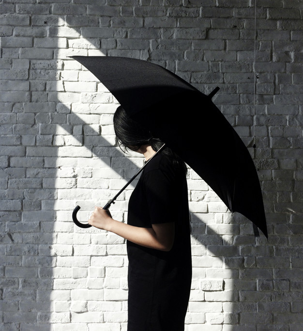 A Girl In Black Cloths Holding A Black Umbrella PSD Template.