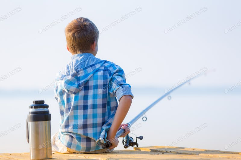 A Kid In Blue Shirt Catching Fish PSD Template.