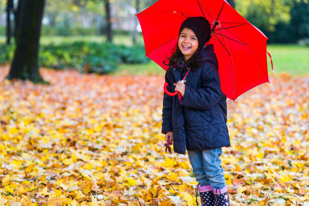 A Little Girl Under A Red Umbrella PSD Mockup.