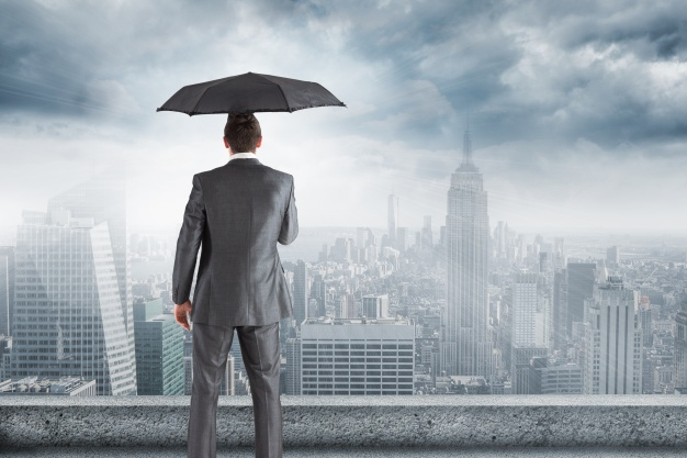A Man In Suit Looking At The City Holding An Umbrella PSD Template.