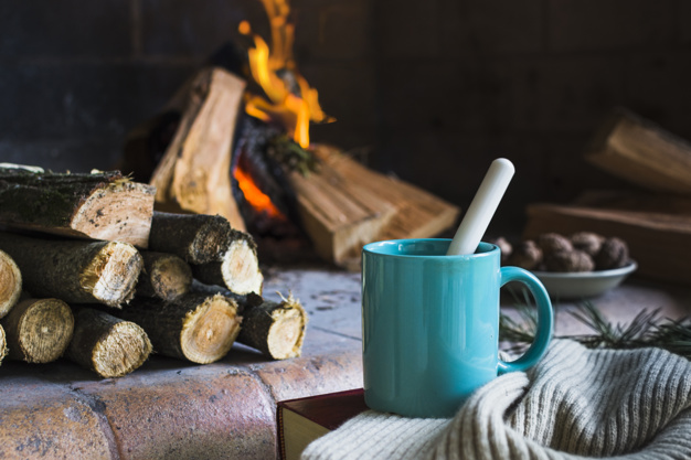 A Mug Is Placed With A Blanket Near Fireplace Template.
