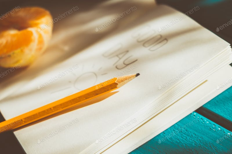 A Pencil Is Placed On Opened Dairy PSD.