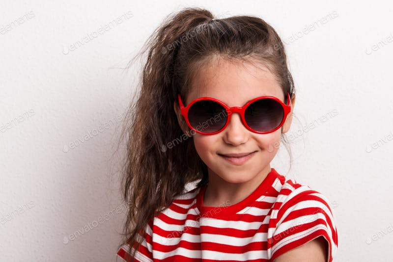 A Small girl In Red Sun glass And Striped T-shirt Mockup.