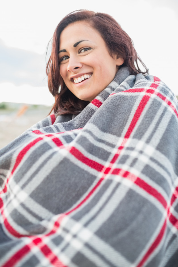 A Smiling Girl Covered With Blanket Mockup.