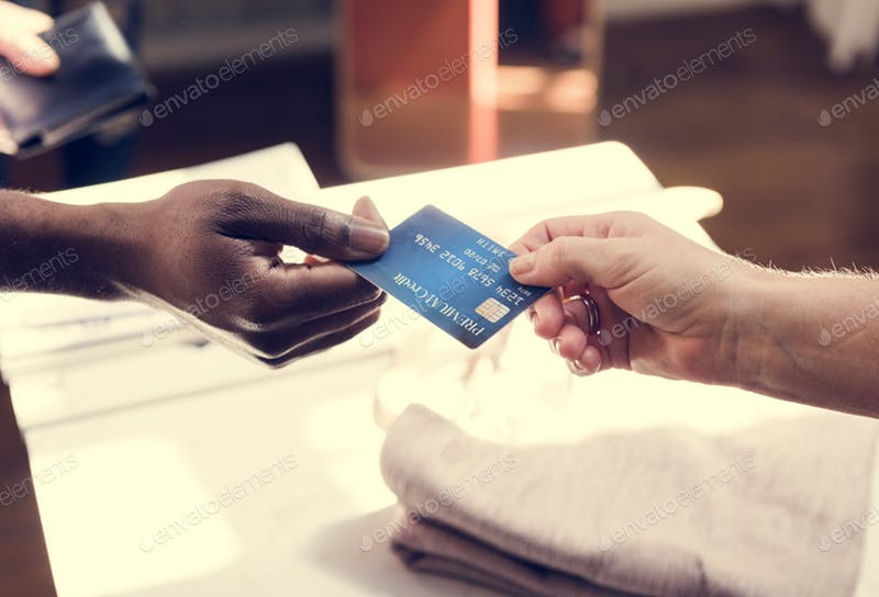 A man is giving a Credit card to another person mockup.