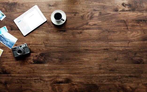 Aerial view of wooden table and photography hobby concept Free Psd