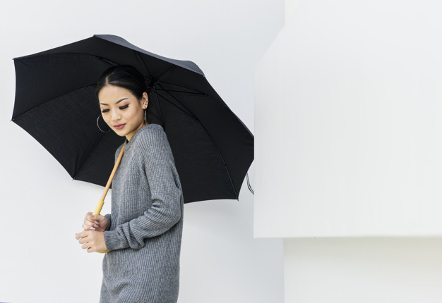 An Asian Girl Holding A Black Colored Umbrella PSD Template.