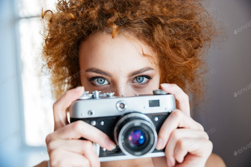 An Attractive Redhead Women Taking Photo with An Old Camera PSD Template.
