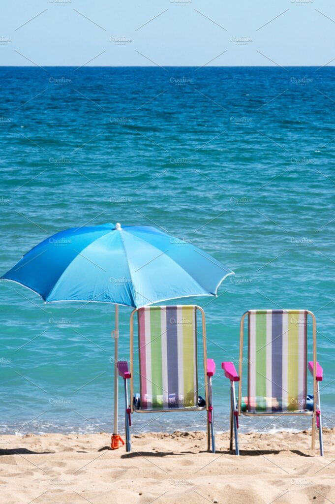An Umbrella Is Attached With a Chair Near A Sea Mockup.