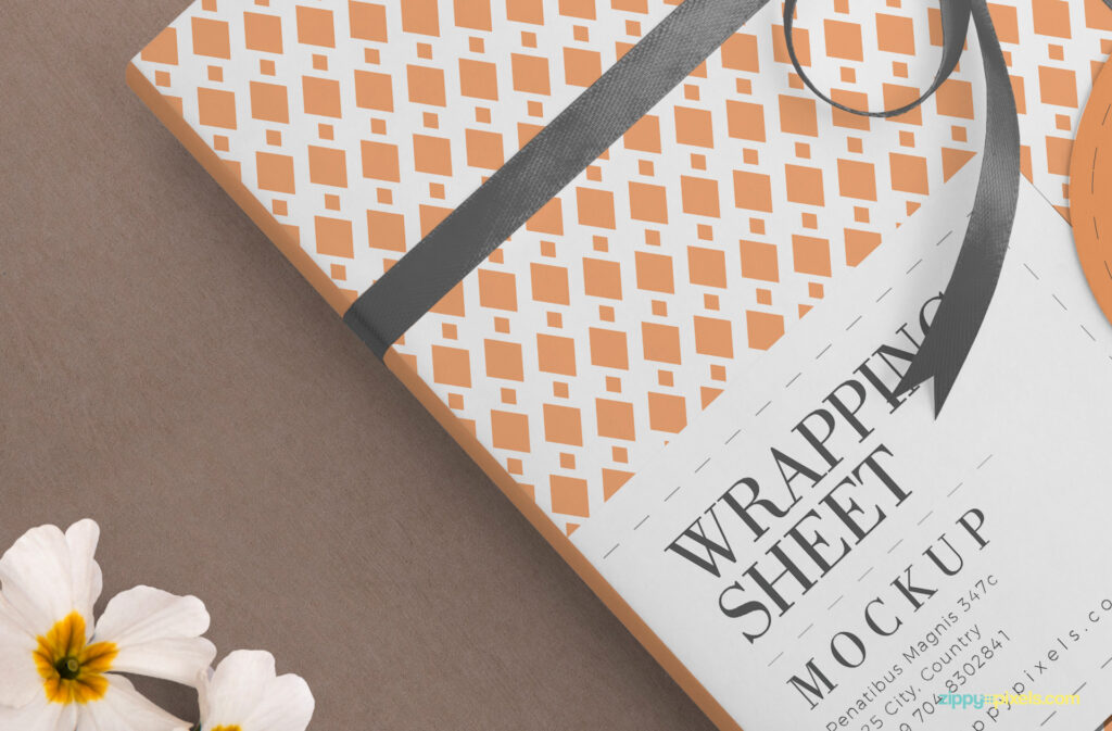 Book Wrapped with an Orange Wrapping Paper PSD Mockup