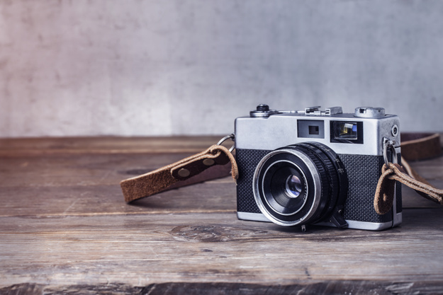Camera Kept On Wooden Table Mockup