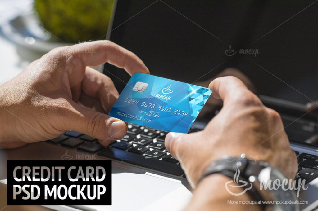 Credit Card Holding On A Laptop Mockup.