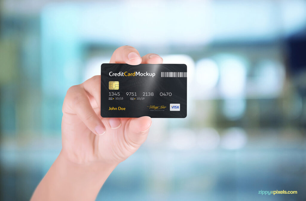 Credit Card In A Hand Mockup.