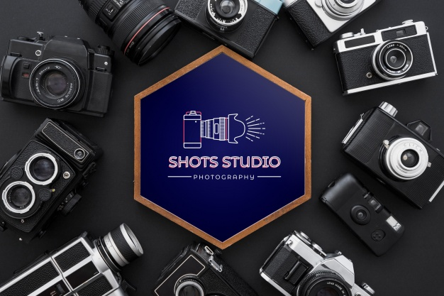 Different Designs Of Camera In A Black Background PSD Mockup.