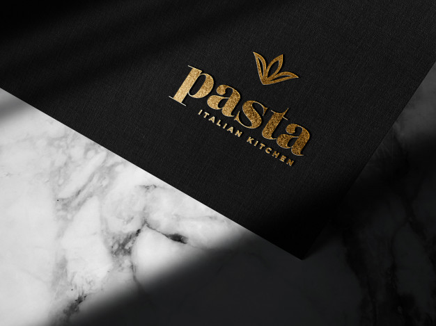 Free Luxury Embossed Gold Logo On Black Paper Mockup PSD Template