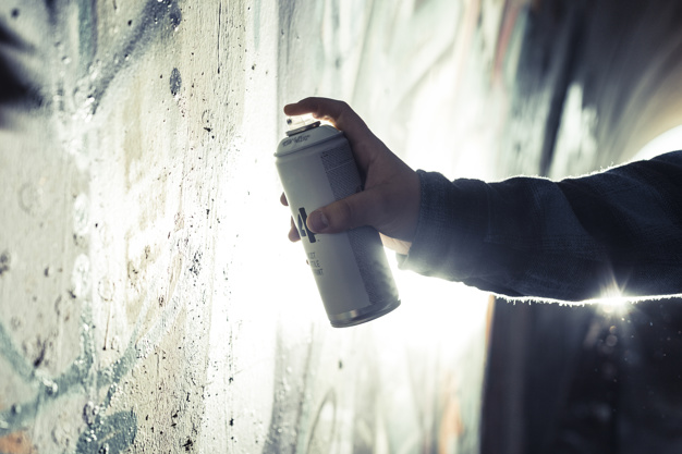 Guy in mood of preparing a masterpiece with spray can Picture