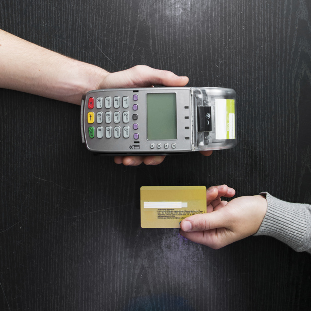 Hand Holding A Card Reader And A Credit Card.