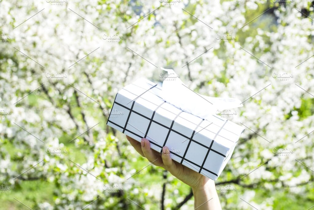 Hand Showcasing Black And White Check Printed Tissue Box Mockup