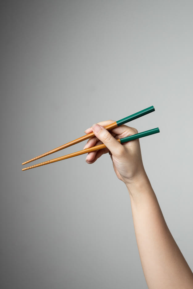 Hand chopstick asian japanese chinese food style traditional Premium Photo