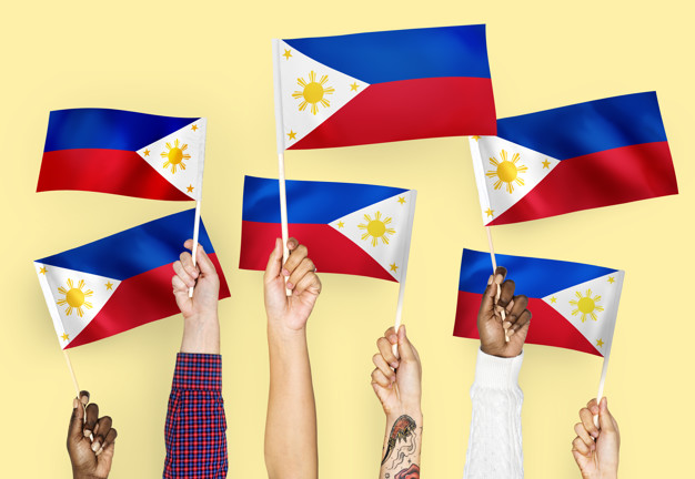 Hands Waving The Flag Of Philippines.