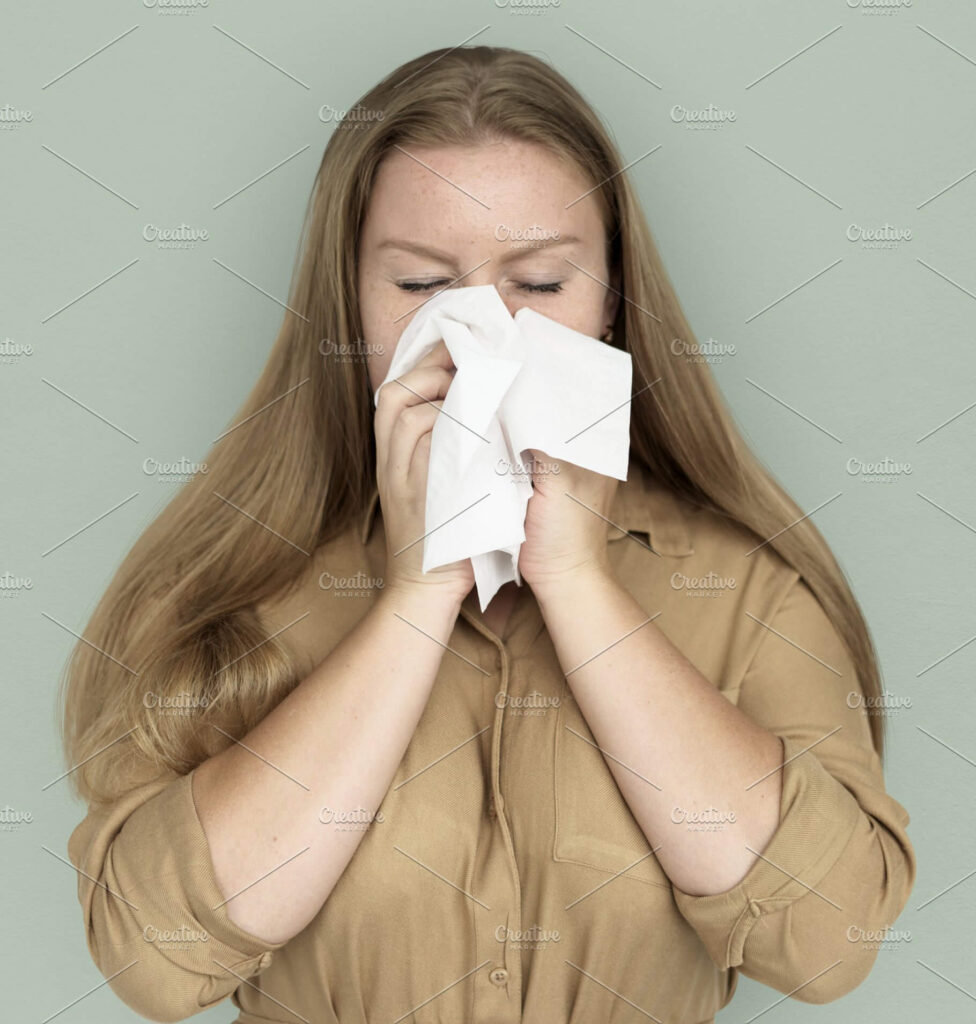 Hygienic tissue paper: Girl Blowing Her Nose With White Tissue